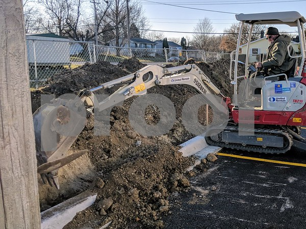 Sean Morrisroe, of Morrisroe Electric, digs a trench for the electrical work at the new Hardee's going up on DeKalb Avenue in Sycamore. The Hardee's a part of a spate of new commercial construction going up in Sycamore.
