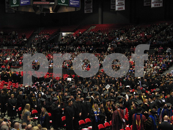 Students enter the NIU Convocation Center as part of the winter commencement ceremony on Sunday, Dec. 11, 2016 in DeKalb.