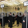 Graduates line up with their classmates before NIU's winter commencement ceremony on Sunday, Dec. 11, 2016 at the Convocation Center in DeKalb.