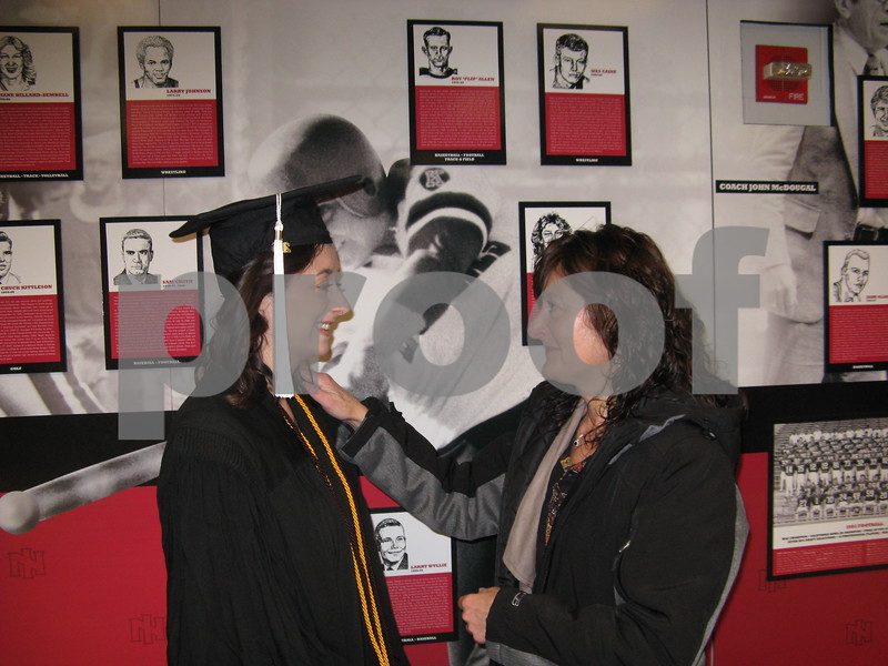 Linda Doden (right) shares a moment with her daughter, Bethany Doden, before NIU's winter commencement ceremony on Sunday, Dec. 11, 2016 at the Convocation Center in DeKalb.