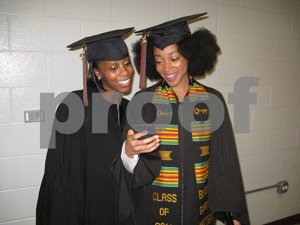 Erica Joy Ventress and Kristen Glover are all smiles before walking in NIU's undergraduate winter commencement ceremony on Sunday, Dec. 11, 2016 at the Convocation Center in DeKalb.
