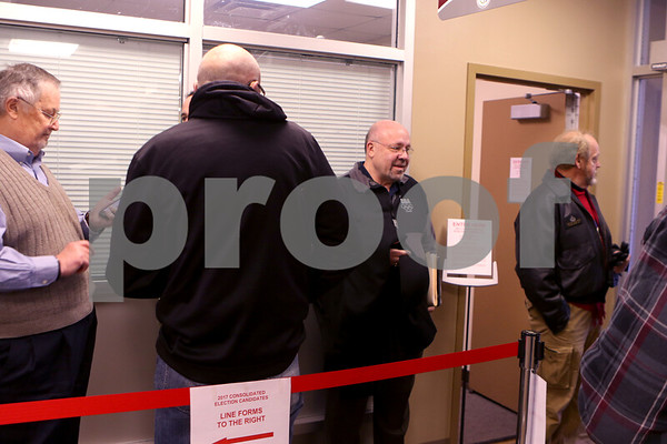 Sam Buckner for Shaw Media.<br /> Current Mayor John Rey along with others wait in line to get their name on the ballot on Monday December 12, 2016.
