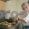 Congregation member Jeff Hecht makes latkes for the Hannukah celebration.