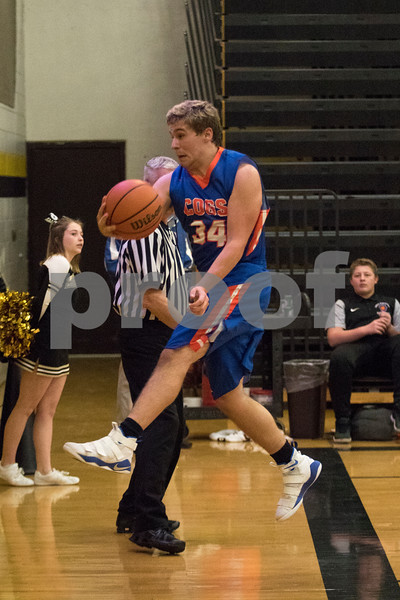 Sam Buckner for Shaw Media.<br /> Kollin Fugate saves a ball from going out of bounds on Tuesday December 12, 2017 at Sycamore High School.