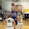 Sam Buckner for Shaw Media.<br /> Griffin Hansen takes a jump shot on Tuesday December 12, 2017 at Sycamore High School.