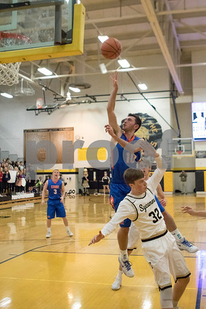 Sam Buckner for Shaw Media.<br /> Nate Nesler shoots a layup on Tuesday December 12, 2017 at Sycamore High School.