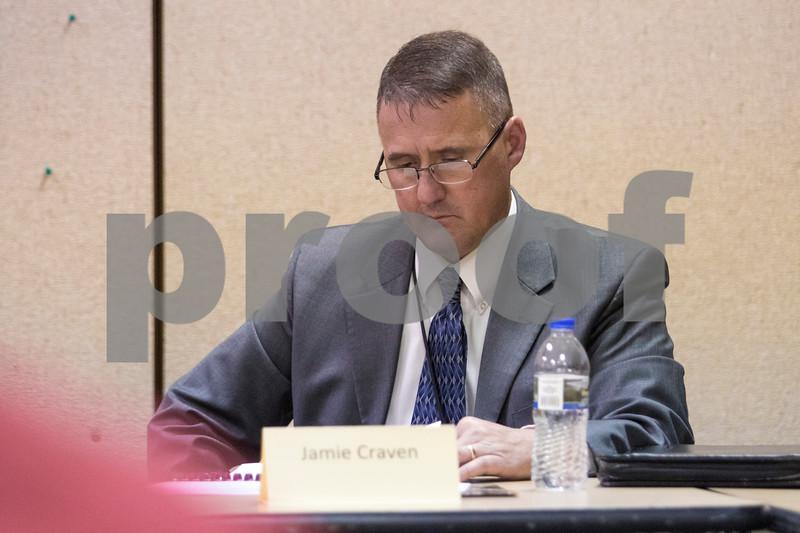 Sam Buckner for Shaw Media.<br /> Superintendent Jaime Craven looks over charts on proposed tax plans on Wednesday December 13, 2017.