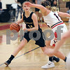 Sycamore's Faith Klemm (14) looks for an inside pass against Yorkville's Claudia Grunwald during a girls varsity basketball game at Yorkville High School on Tuesday, December 12, 2017. Steven Buyansky - For Shaw Media