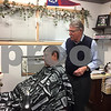 Don Henderson (right) owner of Spartan Style Barbershop at 550 Route 64 in Sycamore, has been a barber for more than 60 years. Spartan Style is celebrating its 40th year anniversary this month.