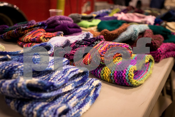 Sam Buckner for Shaw Media.<br /> Hats are layed out on a table at the 3rd annual Warm Coat Giveaway at the DeKalb Fire Department on Wednesday December 14, 2016.