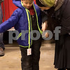 Sam Buckner for Shaw Media.<br /> Axel Jaen tries on his new coat at the coat drive on Wednesday December 14, 2016.