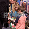 Sam Buckner for Shaw Media.<br /> Ryan Janisch helps son Grady Janish (5) and friend Isla Gerhardt (6) complete a scavenger hunt at the Sycamore Public Library holiday open house on Wednesday December 14, 2016.