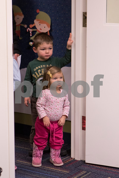 Sam Buckner for Shaw Media.<br /> Lukas (3) and Claire Kozlow (1) wait in line to talk to Santa at the Sycamore Public Library holiday open house on Wednesday December 14, 2016.