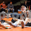 Sam Buckner for Shaw Media.<br /> Jacob Lindemann looks up at the clock while trying to pin Dan Grant of Morris on Thursday December 14, 2017 in the 132lb bout.