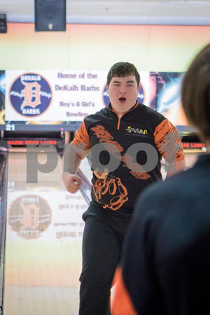Sam Buckner for Shaw Media.<br /> Jacob Hanson celebrates a strike in a meet against Sycamore on Thursday December 14, 2017.