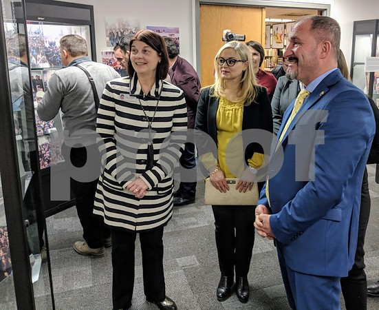NIU acting president Lisa Freeman (left) tours the new exhibit at the Blackwell History of Education Museum with University of Tetova president Vullnet Ameti (right) and his wife Makfirete Ameti. The exhibit tells the history of the university, which was not recognized by the Macedonian government for its first decade.