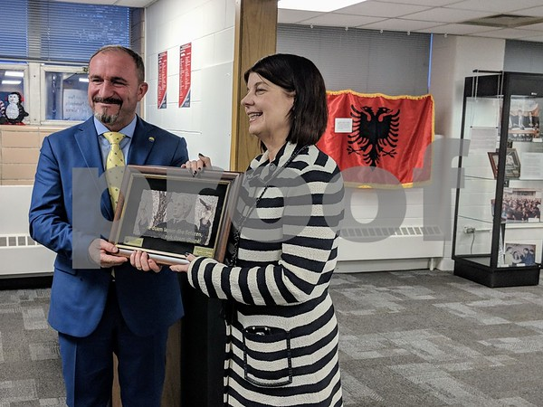 """Ameti presented Freeman with a photo of University of Tetova founder Fadil Sulejmani at the opening of the exhibit. """"The University of Tetova and the Struggle for Education Equity in the Republic of Macedonia"""" will run through May 11 at the Blackwell History of Education Museum located in Gabel Hall."""