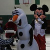 Kristi Garabrandt — The News-Herald <br> Mickey Mouse tries to sneak up on Olaf while he visits with Alvin Horton.