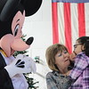 Kristi Garabrandt — The News-Herald <br> Madison Price visits with Mickey Mouse.