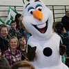 Kristi Garabrandt — The News-Herald <br> Olaf poses for photos with Broadmoor students.