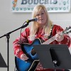 Kristi Garabrandt — The News-Herald <br> Libby Smith performs on guitar while singing Christmas songs such as Rudolph the Red Nose Reindeer and Frosty the Snowman.
