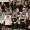 Sam Buckner for Shaw Media.<br /> Sycamore bench players and fans cheer on their Spartan teammates as they huddle during a timeout against Kaneland on Friday, Dec. 15, 2017 at Kaneland High School in Maple Park.