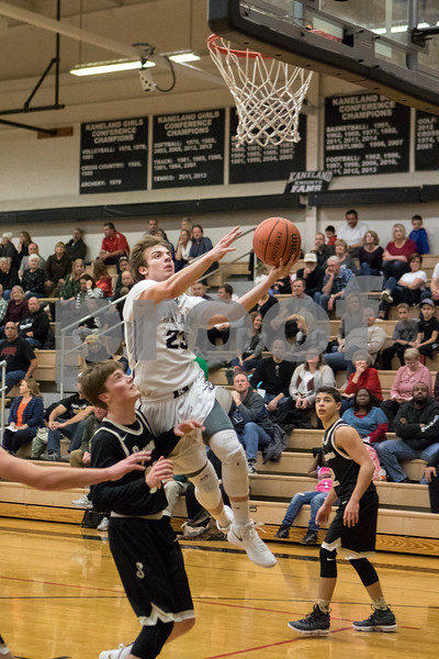 Sam Buckner for Shaw Media.<br /> Kaneland's Blake Feiza takes a layup against Sycamore on Friday, Dec. 15, 2017 at Kaneland High School in Maple Park.