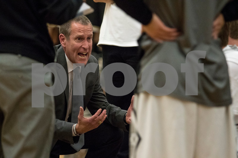 Sam Buckner for Shaw Media.<br /> Kaneland head Coach Joe Conroy gives instructions to the Knights during a timeout in the first quarter against Sycamore on Friday, Dec. 15, 2017 at Kaneland High School in Maple Park.