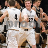 Sam Buckner for Shaw Media.<br /> Kaneland's Brett David and Wyatt Peeler congratulate each other on the win against Sycamore on Friday, Dec. 15, 2017 at Kaneland High School in Maple Park.