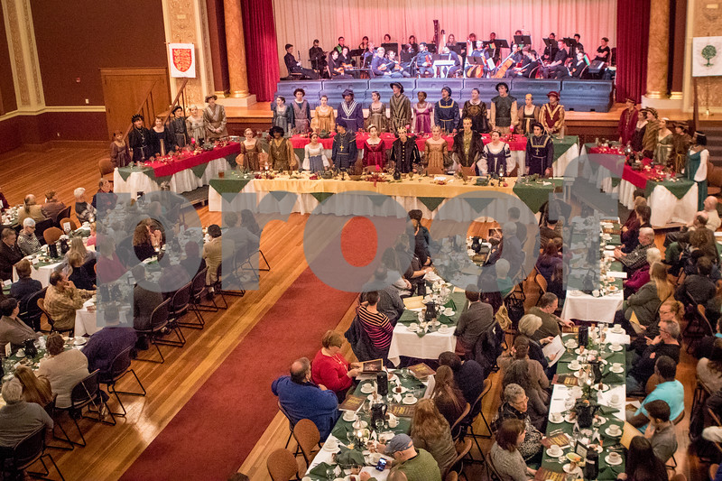 Sam Buckner for Shaw Media.<br /> A packed house listens to carols before dinner is served on Friday December 16, 2016.