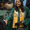 Sam Buckner for Shaw Media.<br /> Sandra Morales walks across the stage at the commencement ceramony on Saturday December 16, 2017.