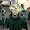 Kishwaukee College graduate Chelsea Erickson, along with her fellow graduates, prepare to walk in the college's fall commencement ceremony Saturday.