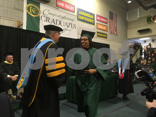 Kishwaukee College graduate Wilma Diez accepts her Associate in Science degree during the college's first fall commencement ceremony Saturday.