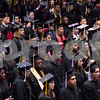 Sam Buckner for Shaw Media.<br /> Graduates stand as they are recongnized as officially being NIU Alumni on Sunday December 17, 2017.