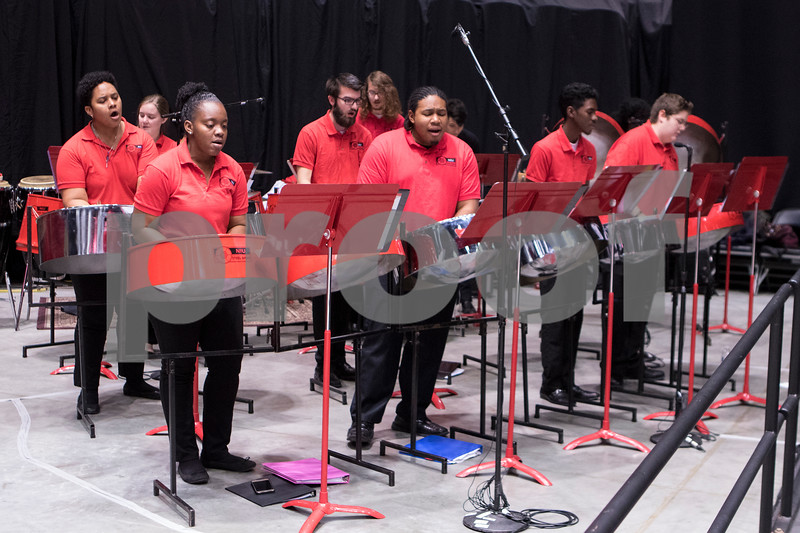 Sam Buckner for Shaw Media.<br /> NIU Steel band performs before the Commencement ceramony on Sunday December 17, 2017 at the Convocation Center.