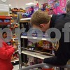 DeKalb Police Department Detective Sonny Streit helps 8-year-old Desiree Barrios shop during the Heroes and Helpers event Sunday at Target in DeKalb.