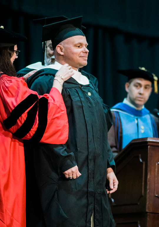 . Shawn McGuirk, of Fitchburg, receives his graduate hood during the 121st Annual Graduate Commencement at Fitchburg State University on Thursday, May 18, 2017. SENTINEL & ENTERPRISE / Ashley Green
