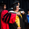 Joana Dos Santos receives her graduates hood  during the 121st Annual Graduate Commencement at Fitchburg State University on Thursday, May 18, 2017. SENTINEL & ENTERPRISE / Ashley Green