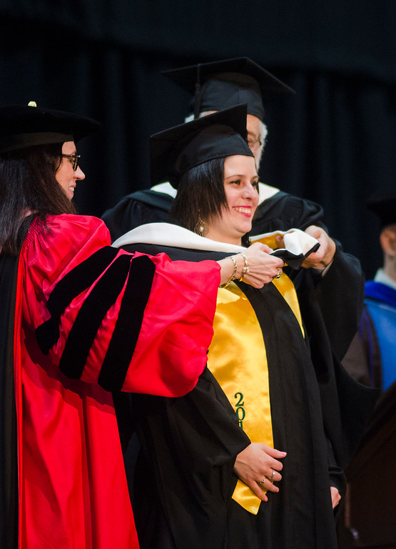 . Joana Dos Santos receives her graduates hood  during the 121st Annual Graduate Commencement at Fitchburg State University on Thursday, May 18, 2017. SENTINEL & ENTERPRISE / Ashley Green