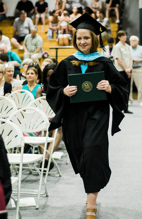 . Tracey Cavaco, of Westminster, returns to her seat with diploma in hand during the 121st Annual Graduate Commencement at Fitchburg State University on Thursday, May 18, 2017. SENTINEL & ENTERPRISE / Ashley Green
