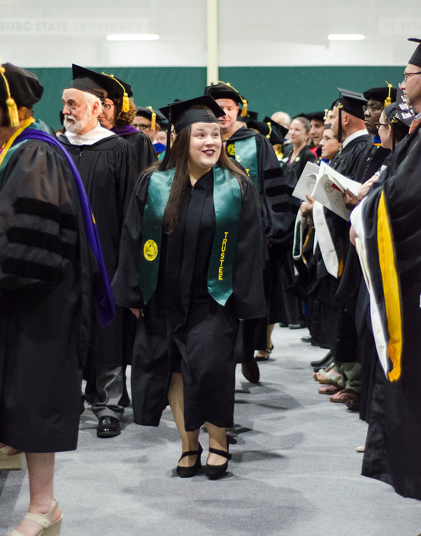 . Student Trustee Abigail Cochran enters the 121st Annual Graduate Commencement at Fitchburg State University on Thursday, May 18, 2017. SENTINEL & ENTERPRISE / Ashley Green