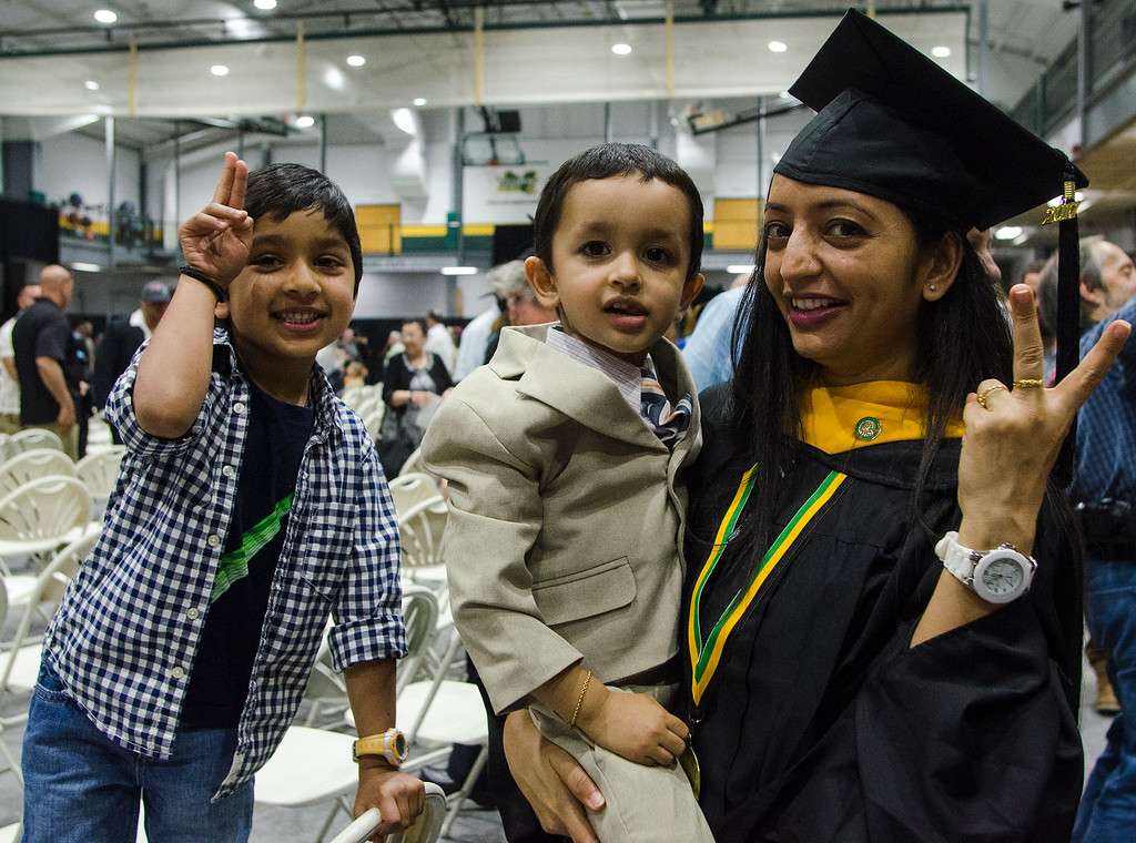 . Hiral Gohel celebrates with Jai, 5, and Aaryan, 3, following the 121st Annual Graduate Commencement at Fitchburg State University on Thursday, May 18, 2017. SENTINEL & ENTERPRISE / Ashley Green