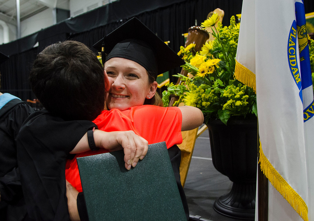 . Jen Karamanian gets a hug from son Nicholas following the 121st Annual Graduate Commencement at Fitchburg State University on Thursday, May 18, 2017. SENTINEL & ENTERPRISE / Ashley Green