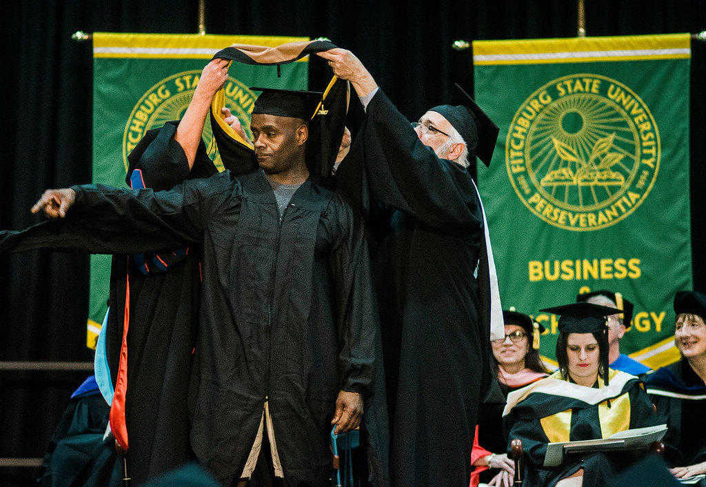 . Marcus Lee Scott, Sr. of Fitchburg, receives his graduate hood during the 121st Annual Graduate Commencement at Fitchburg State University on Thursday, May 18, 2017. SENTINEL & ENTERPRISE / Ashley Green