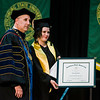 Joana Dos Santos, of Fitchburg, receives the Graduate Student Leadership Award during the 121st Annual Graduate Commencement at Fitchburg State University on Thursday, May 18, 2017. SENTINEL & ENTERPRISE / Ashley Green