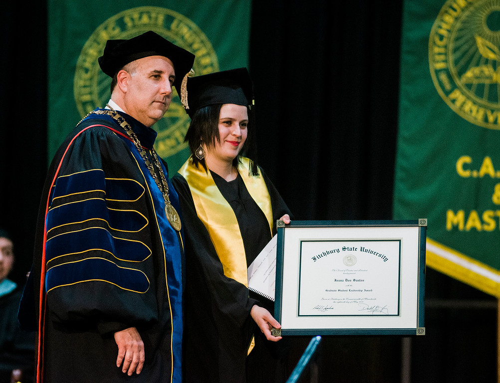 . Joana Dos Santos, of Fitchburg, receives the Graduate Student Leadership Award during the 121st Annual Graduate Commencement at Fitchburg State University on Thursday, May 18, 2017. SENTINEL & ENTERPRISE / Ashley Green