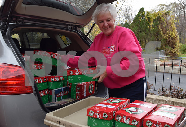 On Nov. 18, Sharon Thompson, a member of Burlington United Methodist Church, unloads 38 shoeboxes from her car for the Operation Christmas Child collection at First Baptist Church of Sycamore. The shoeboxes will be delivered to Tanzania, Zambia, St. Lucia, Madagascar, Zimbabwe and Namiba.