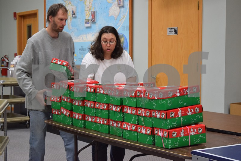 Mark and Colleen Cerutty of Sycamore help organize shoeboxes for Operation Christmas Child on Nov. 18 at First Baptist Church, 530 W. State St. in Sycamore. More than 1,600 shoeboxes were collected locally to be delivered to children in Tanzania, Zambia, St. Lucia, Madagascar, Zimbabwe and Namiba.