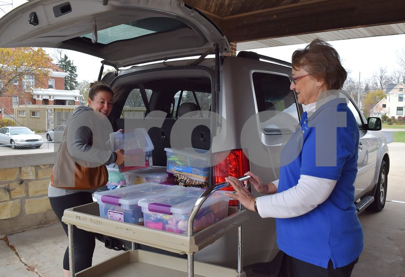 Julie Heinisch of Kingston (left) unloads shoeboxes with the help of Relay Center Coordinator Jane Peters for Operation Christmas Child on Nov. 18, at First Baptist Church, 530 W. State St. in Sycamore. Heinisch and her family collected items that will be sent to six children for Christmas.