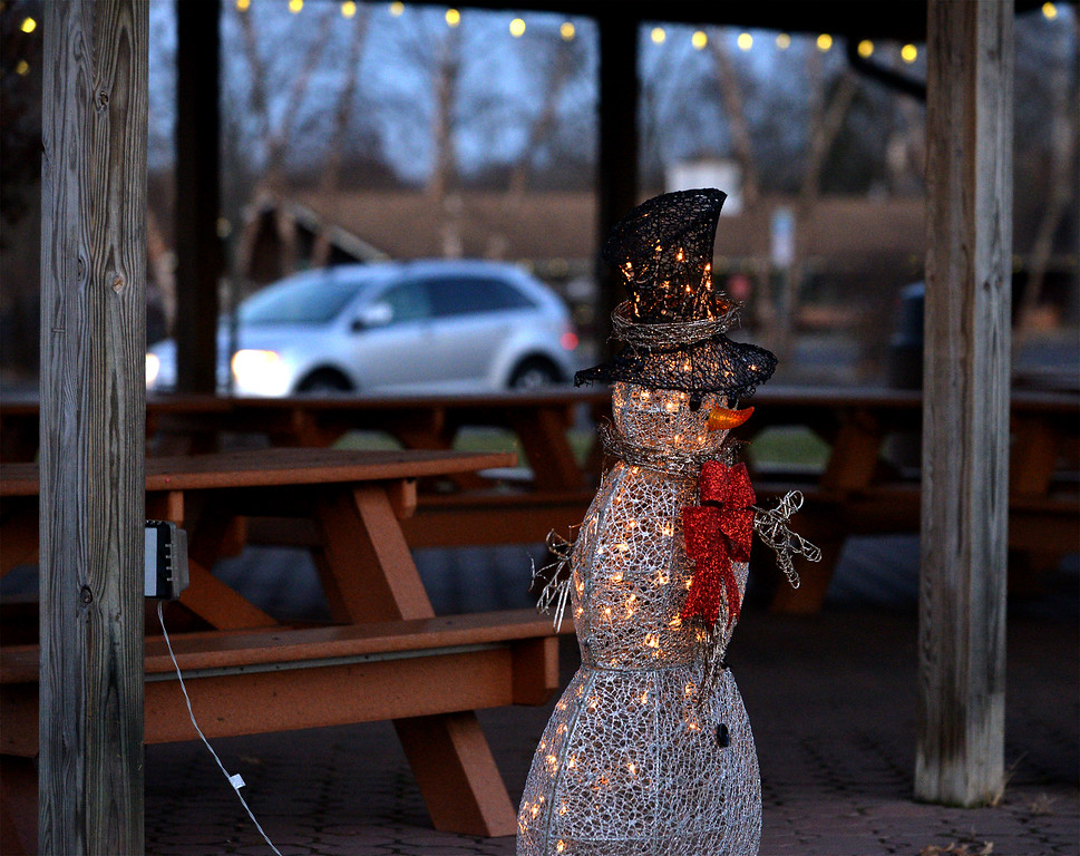 . (Bob Raines-/Digital First Media)  A lighted snowman figure stands by the corner of a pavilion at Fischer\'s Park Dec. 20, 2017.